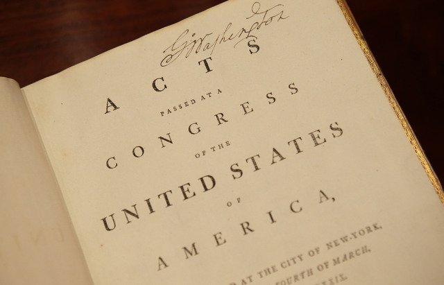 """This photo taken Tuesday, Sept. 24, 2013 shows a 1789 book, """"Acts Passed at a Congress of the United States of America,"""" that belonged to George Washington, and was bought for $9 million ..."""