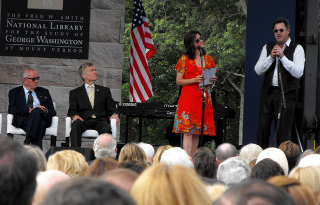 """Fred W. Smith, left, chairman of the Donald W. Reynolds Foundation and Virginia Gov. Bob McDonnell look on as entertainers Amy Grant and Vince Gill sing """"America the Beautiful"""" on Friday, Sept ..."""