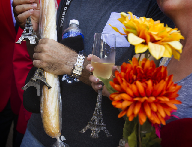 Martin Layton and his fiance, Sarah Connell, from Poole, England, were honored Thursday as the 10 millionth visitor to The Eiffel Tower Experience at Paris Las Vegas. The couple was serenaded by m ...
