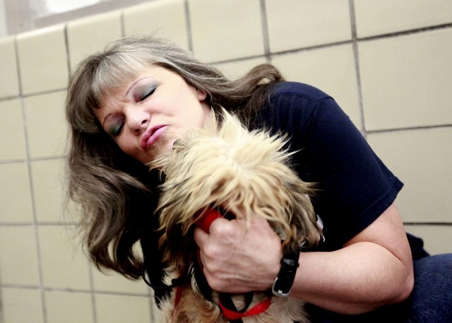 Inmate Jill Rockcastle plays with a dog near her cell at Florence McClure Women's Correctional Center in Las Vegas Monday, July 22, 2013. Dogs live in the facility with inmates as part of the Pups ...