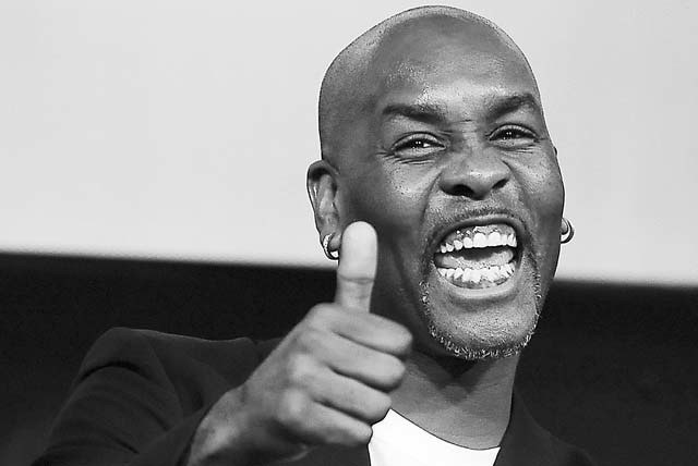 NBA All-Star Gary Payton, a member of the 2013 class of inductees into the Basketball Hall of Fame, gestures during a news conference at the Naismith Memorial Basketball Hall of Fame in Springfiel ...