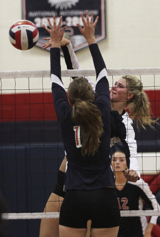 Coronado's Berkeley Oblad (10) spikes the ball past Legacy's Ashley Smoot during their volleyball match in Henderson on Sept. 17, 2013. (Jason Bean/Las Vegas Review-Journal)