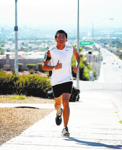 Jessica Ebelhar/Las Vegas Review-Journal Eldorado senior cross country runner Eddie Esquivel trains near East Washington Avenue and Hollywood Boulevard on Sept. 3. Esquivel finished second in the  ...