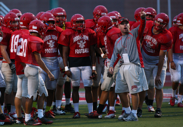 Arbor View head coach Dan Barnson talks with the team during practice at the high school in Las Vegas on Tuesday, Sept. 10, 2013. (Chase Stevens/Las Vegas Review-Journal)