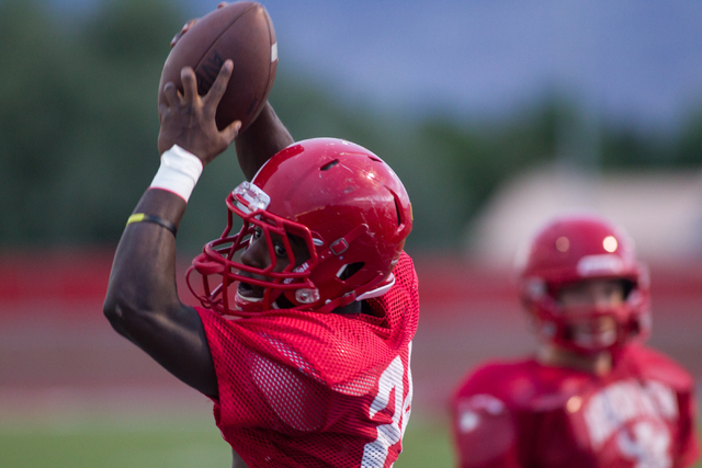 Arbor View's Anthony Smith catches a pass during practice at the high school in Las Vegas on Tuesday, Sept. 10, 2013. (Chase Stevens/Las Vegas Review-Journal)