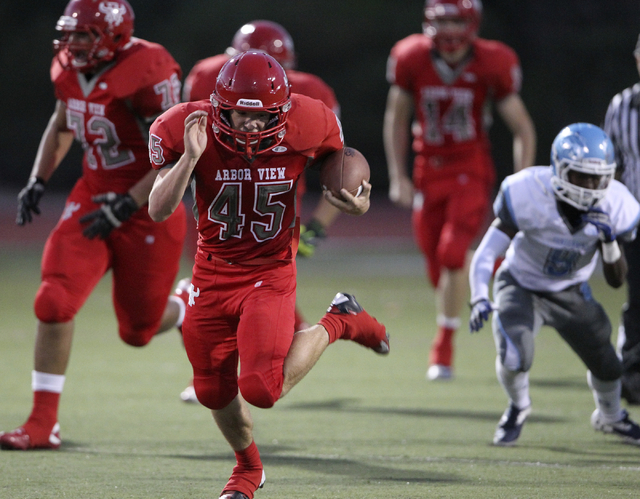 Arbor View running back Ricky Clark goes for 73 yards on the first play from scrimmage against Centennial during their football game at Arbor View High School Thursday, Sept. 12, 2013. (K.M. Canno ...