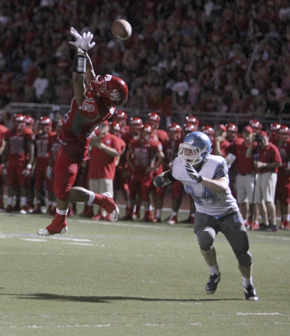 Arbor View running back Devon Turner tries to catch a pass in front of Centennial running back Hunter Brown in the second quarter of their football game at Arbor View High School Thursday, Sept. 1 ...
