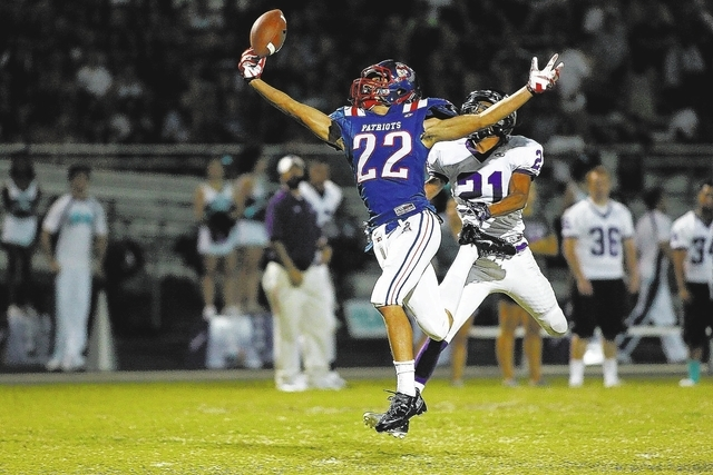 Chase Stevens/Las Vegas Review-Journal Liberty wide receiver Deseon McQuaig makes a leaping catch against Silverado's Daniel Savage and goes on to score one of his three touchdowns in the Pa ...