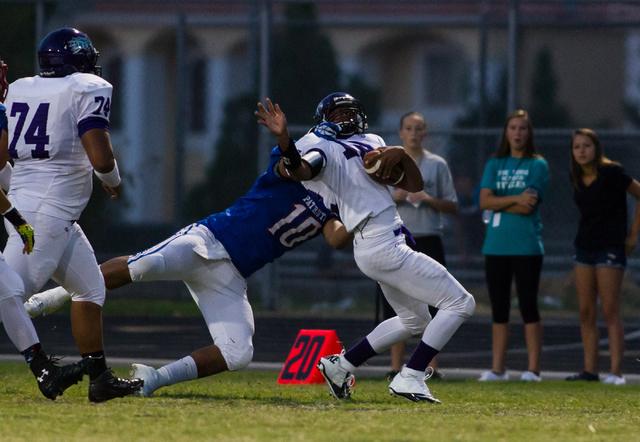 Liberty's O'Shay Jordan (10) tackles Silverado's Armani Jones-Sailor (12) during a football game at Liberty High School in Henderson on Saturday, Sept. 7, 2013. Liberty won 35-8 against Silverado. ...