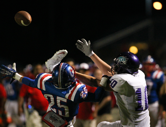 Liberty's Ethan Dedeaux (25) jumps to block a pass to Silverado's Austin Hunt (10) during a football game at Liberty High School in Henderson on Saturday, Sept. 7, 2013. Liberty won 35-8 against S ...