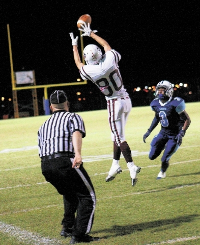 Desert Oasis' Shawn Sanchez (80) attempts to catch a pass in front of Canyon Springs' A.J. Cooper (3)  during their football game in North Las Vegas on Sept. 27, 2013. (Jason Bean/Las Vegas Review ...