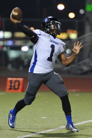 Desert Pines quarterback Iquan Corsey (1) throws the ball against Valley during a football game at Valley High School in Las Vegas Thursday, Sep. 12, 2013. (David Cleveland/Las Vegas Review-Journal)