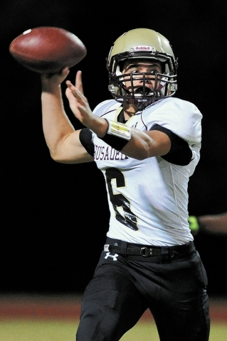 Faith Lutheran's Jacob Deaville (6) looks for a receiver during a football game against Mojave at Mojave High School, North Las Vegas, Nev. Friday, Sept. 27, 2013. (David Cleveland/Las Vegas Revie ...