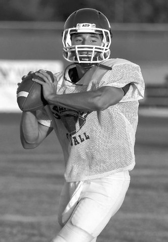 Green Valley quarterback Christian Lopez makes some throws during practice in preparation for their upcoming game against Palo Verde in Henderson on Sept. 18, 2013. (Jason Bean/Las Vegas Review-Jo ...