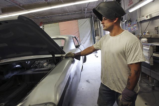 An inmate worker takes a break from a welding job while participating in the car restoration program, operated through Silver State Industries, at the Southern Desert Correctional Center near Indi ...