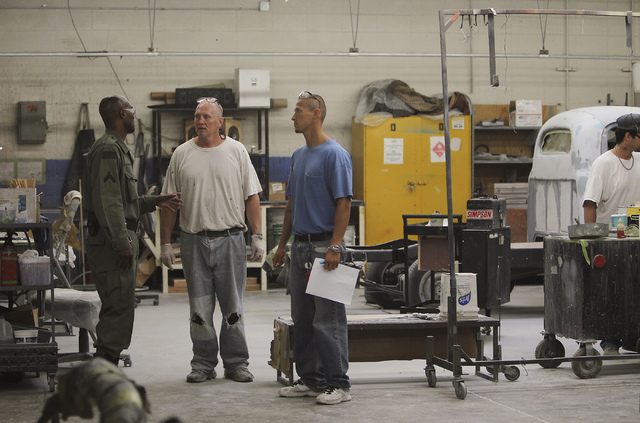 Inmate workers in the car restoration program, right, talk with a correctional officer at the Southern Desert Correctional Center near Indian Springs on Sept. 12, 2013. (Jason Bean/Las Vegas Revie ...