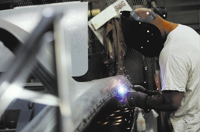 An inmate worker welds body panels together while participating in the car restoration program, operated through Silver State Industries, at the Southern Desert Correctional Center near Indian Spr ...