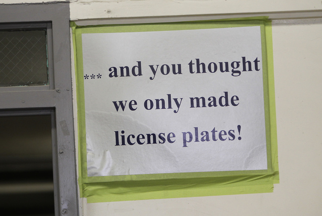 A sign seen in the garage area of the car restoration program, operated through Silver State Industries, at the Southern Desert Correctional Center near Indian Springs on Sept. 12, 2013. (Jason Be ...