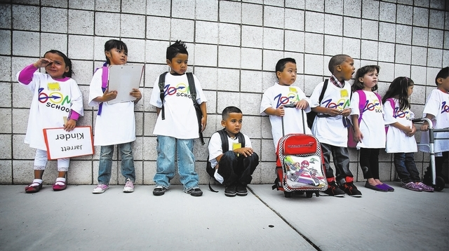 Kindergarten students stand in line before the start of the first day of school at Cambeiro Elementary School at 2851 E. Harris Avenue on Monday Aug. 26. Cambeiro is one of 14 Clark County element ...