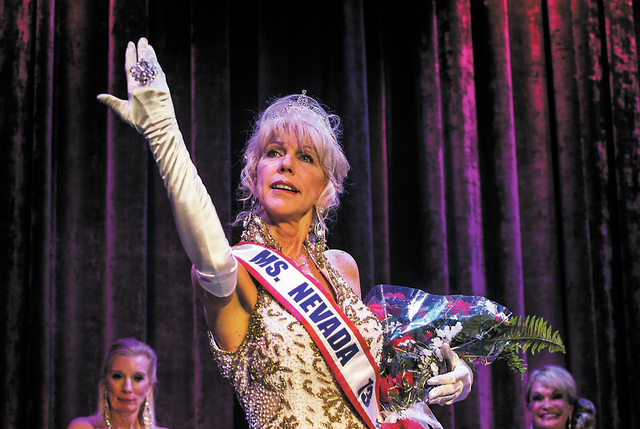 Kathleen (Kat) Ray celebrates after being crowned Ms. Senior Nevada Pageant at  the South Point Casino-Hotel Showroom on Wednesday, Aug. 21, 2013.  In the background is Diane Carozza, left, and Pr ...