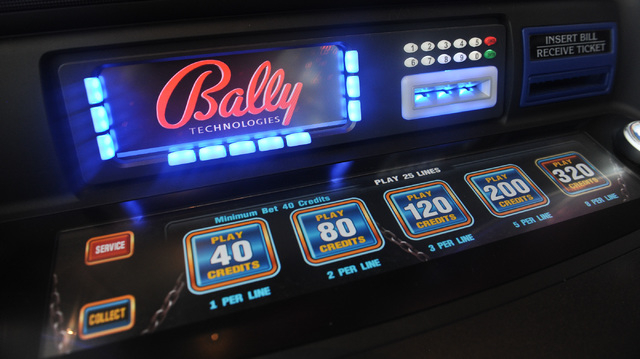 Bally Technologies logo is seen on a slot machine inside a showroom at Bally Technologies in Las Vegas Thursday, Sep. 12, 2013. (David Cleveland/Las Vegas Review-Journal)
