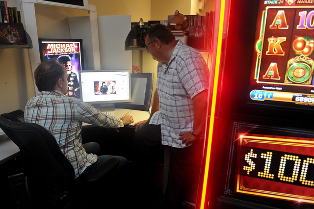 Graphic Artist Gregory Tobey, left, and Director of Game Development Ian Arrowsmith work on a project at Bally Technologies in Las Vegas Thursday, Sep. 12, 2013. (David Cleveland/Las Vegas Review- ...