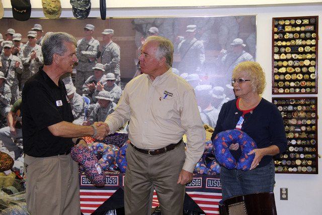 Doug Bradford of USO Las Vegas accepts a travel pillow donation from Dixon Keller of Humana and Sharon Sacramento, a member of the Humana Charity Crafters. (Special to View)