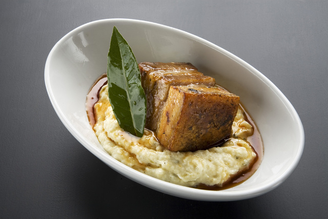 Jeferson Applegate/Las Vegas Review-Journal A plate of pork belly, white grits, bitter greens and apple-cider sauce is seen at Echo & Rig in Tivoli Village.