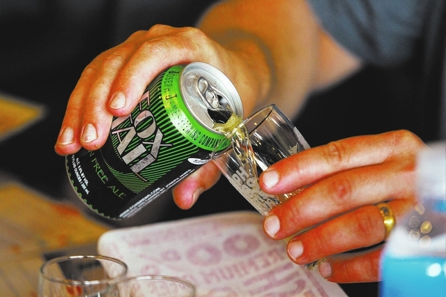 Joseph James Brewing Company's Fox Tail Gluten Free Pale Ale is poured into a glass during a tasting and pairing at Smashburger at 9400 S. Eastern Ave. in Henderson on Friday, Aug. 16. (Chase Stev ...