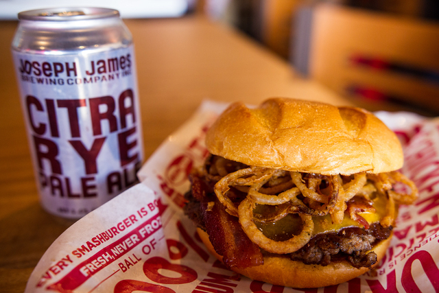 Smashburger's BBQ, Bacon & Cheddar burger, made with applewood-smoked bacon, cheddar cheese, haystack onions and BBQ sauce on an egg bun, is paired with Joseph James Brewing Company's Citra Rye Pa ...