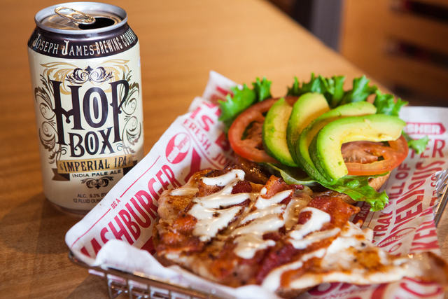 Smashburger's Avocado Club, made with avocade, applewood-smoked bacon, lettuce, tomato, ranch dressing, and mayo on a multi-grain bun, is paired with Joseph James Brewing Company's Hop Box Imperia ...