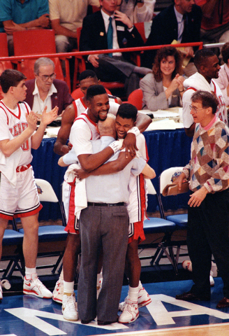 Susan Ragan/the associated press UNLV coach Jerry Tarkanian is hugged by Moses Scurry, left, and Anderson Hunt as time runs out in the Rebels' 103-73 victory over Duke in the 1990 NCAA champ ...