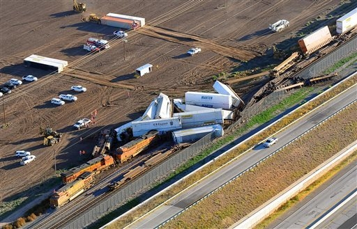 This aerial photo shows the scene where three freight trains collided near Amarillo, Texas on Wednesday, Sept. 25, 2013. An eastbound BNSF Railway train rear-ended a stopped train, derailing up to ...