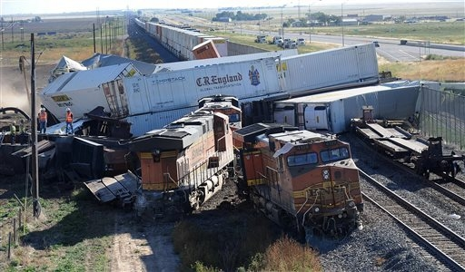 Cars are derailed where three freight trains collided near Amarillo, Texas on Wednesday, Sept. 25, 2013. An eastbound BNSF Railway train rear-ended a stopped train, derailing up to 30 cars and inj ...