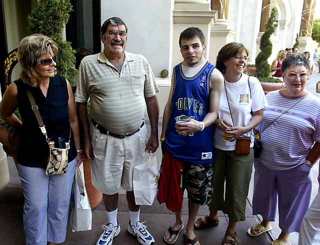 Tourists from Washington and Oregon, from left, Karen Roberts, Dick Powell, Vince Myers, Kathy Myers, and Phyllis Powell stand near the entrance of the Forum Shops at Caesars Palace July 21, 2006. ...