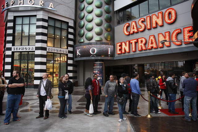 People stand in line outside Planet Hollywood hotel-casino on Wednesday, Dec. 15, 2010, in Las Vegas. (File, JOHN LOCHER/LAS VEGAS REVIEW-JOURNAL)