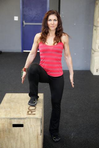 Trainer Laura Salcedo demonstrates the starting position for the single leg step up exercise on Wednesday, Sep. 4, 2013. (Justin Yurkanin/Las Vegas Review-Journal)