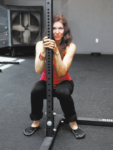Trainer Laura Salcedo demonstrates the wrong ankle  position for the ankle pre-hab standing technique  on Wednesday, Sep. 4, 2013. (Justin Yurkanin/Las Vegas Review-Journal)
