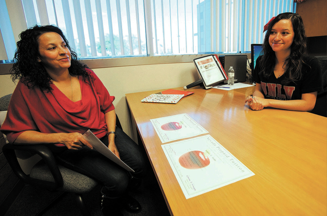 UNLV junior and Housing and Residential Life Community Operations Manager Ashley Seda, right, shares a smile with her mother, Liz, while talking about the prepaid tuition program at her office on  ...