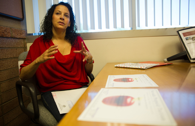 Liz Seda talks with her daughter Ashley (not pictured), a UNLV junior, about the prepaid tuition program on Thursday, Sept. 26, 2013. (Chase Stevens/Las Vegas Review-Journal)