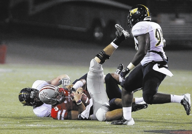 UNLV quarterback Nick Sherry gets sacked by Northern Arizona during their NCAA football game at Sam Boyd Stadium in Las Vegas Saturday, Sept. 8, 2012. (John Locher/Las Vegas Review-Journal)