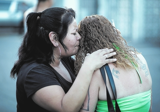 Rosie Lopez, left, embraces a woman during a Stop the Violence Rally in Las Vegas Friday, Sept. 13, 2013. (John Locher/Las Vegas Review-Journal)