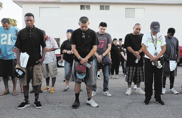 People pray during a Stop the Violence Rally in Las Vegas Friday, Sept. 13, 2013. (John Locher/Las Vegas Review-Journal)
