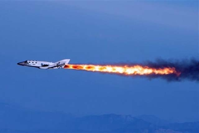 Mark Greenberg/The Associated Press Virgin Galactic's SpaceShipTwo fires its rockets over Mojave, Calif. in April.