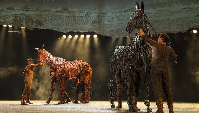 "Two performers inside, and one outside, bring each ""War Horse"" equine to life, controlling the head, heart and hindquarters as the horse experiences everything from pulling a plow to participa ..."