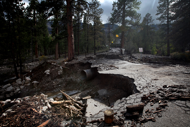 A heavily damaged Rainbow Canyon Boulevard, an entrance to the Rainbow subdivision on Mount Charleston, is seen after heavy rains Sunday, Sep. 1, 2013. (Jessica Ebelhar/Las Vegas Review-Journal)