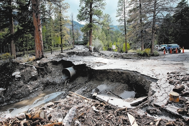 Jessica Ebelhar/Las Vegas Review-Journal A heavily damaged Rainbow Canyon Boulevard, an entrance to the Rainbow subdivision on Mount Charleston, is seen after heavy rains Sunday, Sep. 1, 2013.