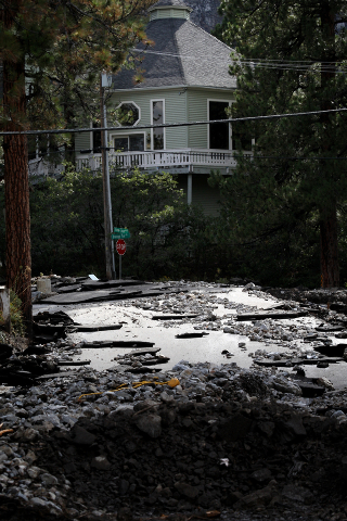 Jessica Ebelhar/Las Vegas Review-Journal A heavily damaged Rainbow Canyon Boulevard, an entrance to the Rainbow subdivision on Mount Charleston, is seen after heavy rains Sunday, Sep. 1, 2013. (Je ...