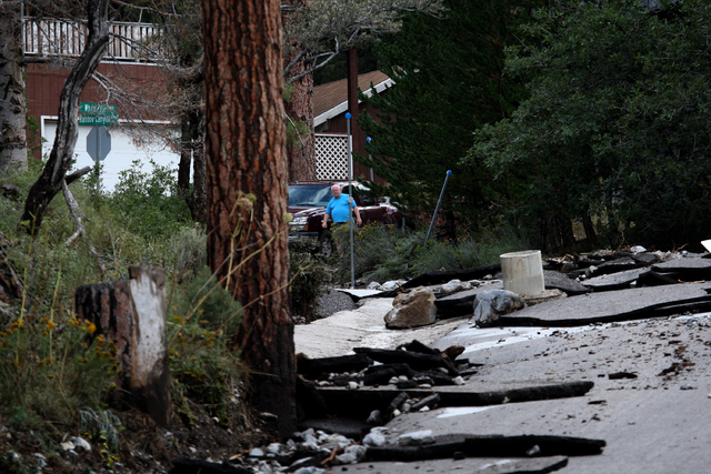 A heavily damaged Rainbow Canyon Boulevard, right, an entrance to the Rainbow subdivision on Mount Charleston, is seen after heavy rains Sunday, Sep. 1, 2013. (Jessica Ebelhar/Las Vegas Review-Jou ...
