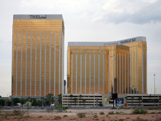 THE Hotel, left, and Mandalay Bay hotel-casino are shown Tuesday, Sept. 10, 2013, in Las Vegas. THE Hotel is expected to transition into the Delano Las Vegas. (Ronda Churchill/Las Vegas Review-Jou ...